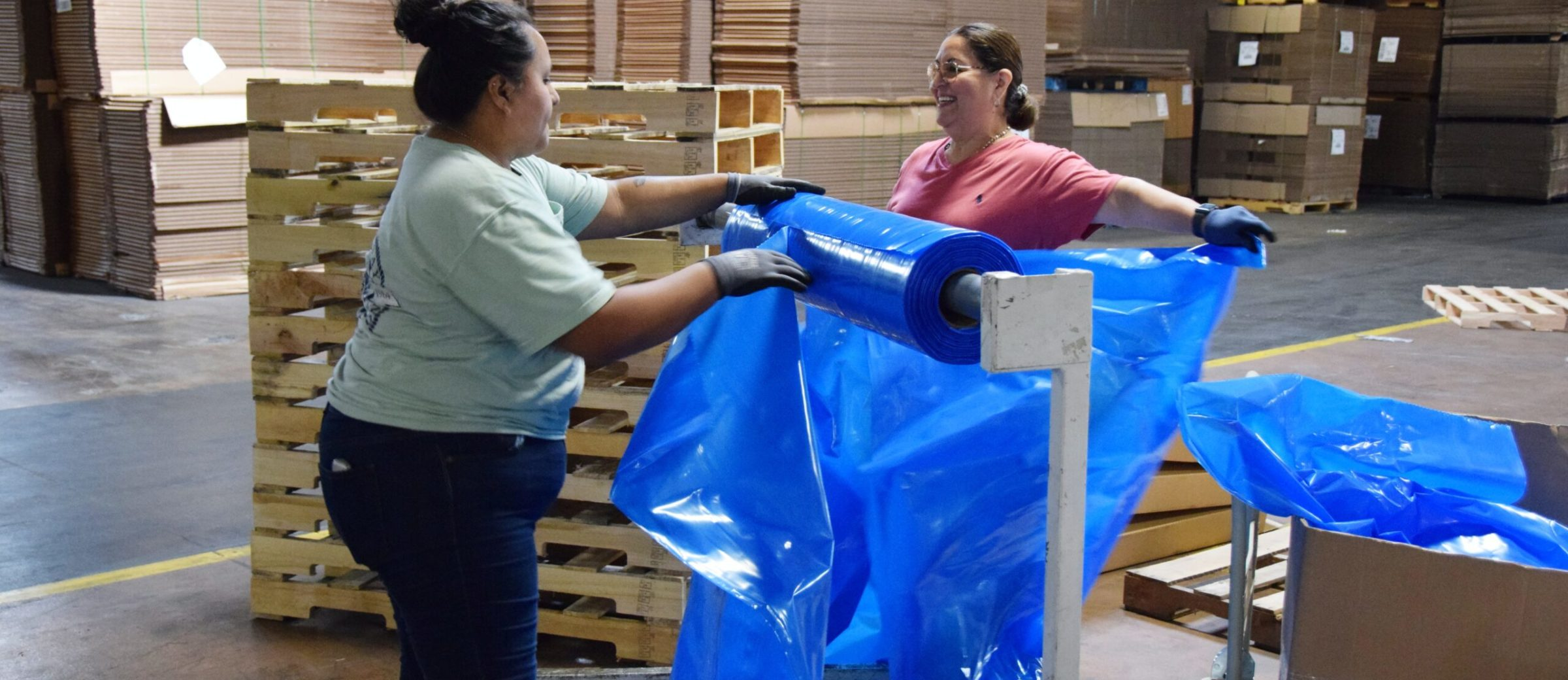 Employees assembling boxes